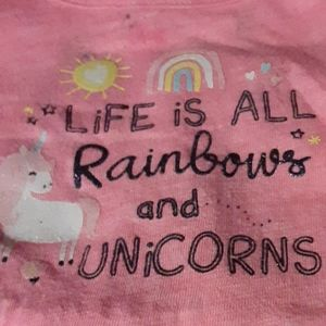 Pink long sleeve onesie with little built-in tutu